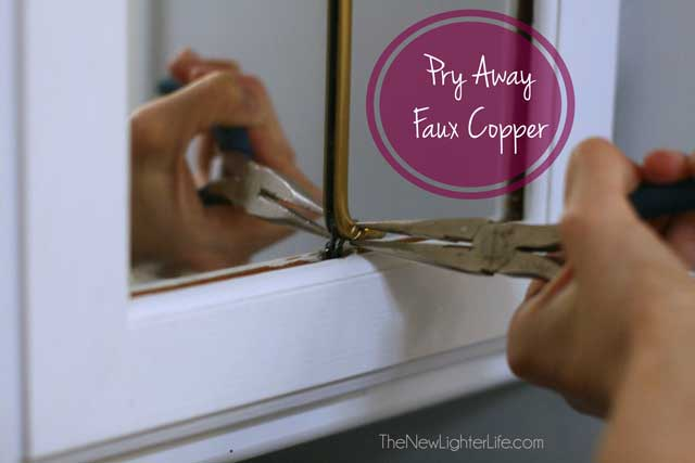 prying-faux-copper-from-paneled-mirror