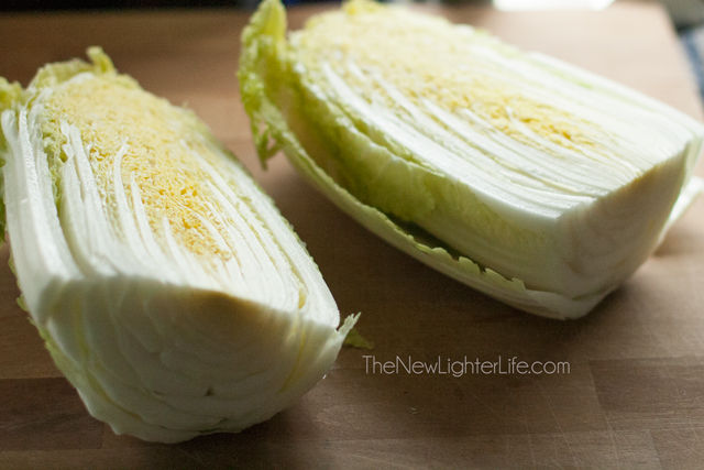 Cut cabbage head in half length-wise.
