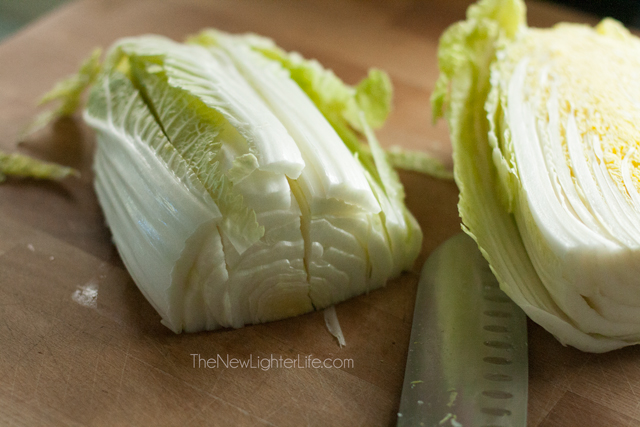 Cut strips down length of napa cabbage head